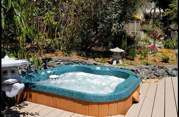 Relax in the hot tub surrounded by gardens and picturesque views.
